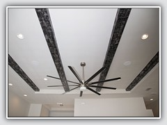 Beams were faux finished with a black base and silver metallic wood grain